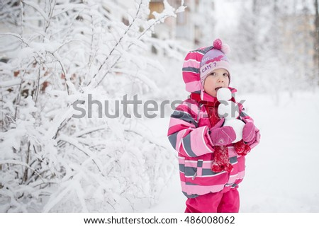 girl eating snowman