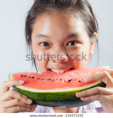 Girl eating water melon - stock photo
