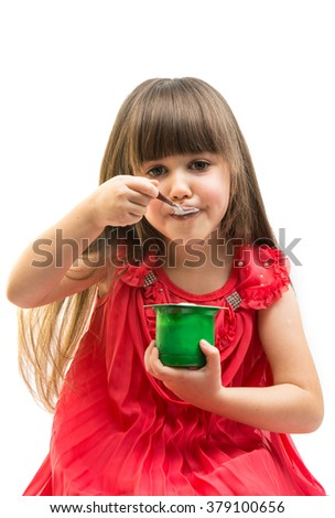 girl eating yogurt on a white background - stock photo