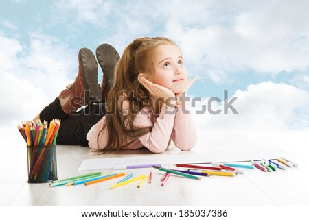 Girl elementary student dreaming about education, looking for drawing idea. Inspiration and creativity concept.  - stock photo