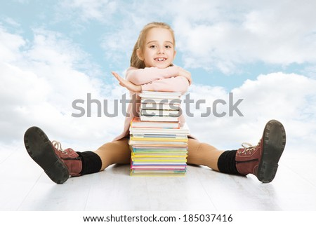 girl elementary student with books stack. Happy school pupil and textbook - stock photo