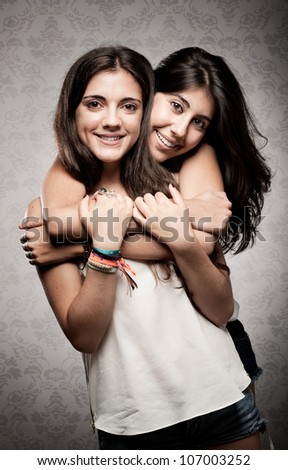 girl embracing her sister - stock photo