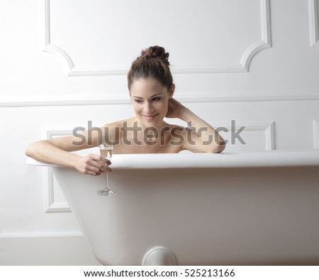 Girl sitting in the shower boobs