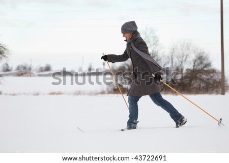 Girl enjoying cross-country skiing - stock photo