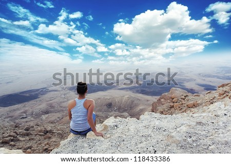 girl enjoys the most beautiful sights in the afternoon canyon