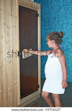 girl entering in the sauna - stock photo
