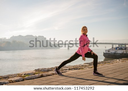 girl  exercise on coasts river - stock photo