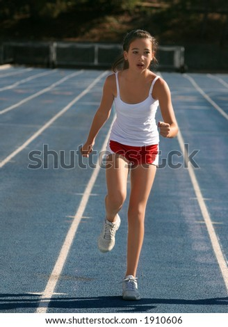 Girl exercising on a blue racetrack - stock photo