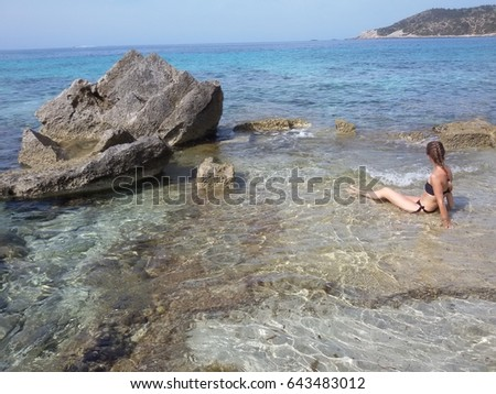 Girl explores the coastline of Ibiza island