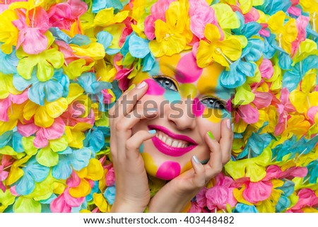 Girl face in flower petals - stock photo