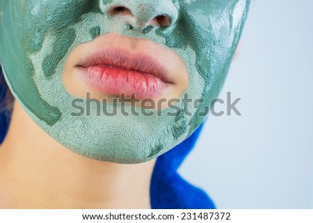 girl face mask which is surprised, on a gray background