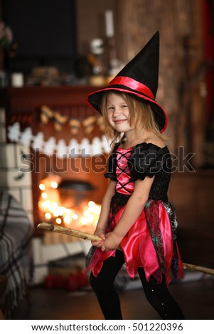Girl fairy, witch flying on a broomstick. The concept of children's games in Halloween, dark background