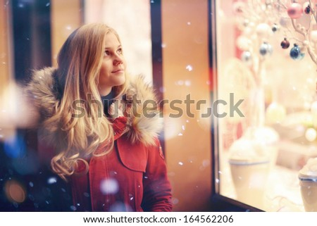 girl fashion night city lights snow purchase sales - stock photo