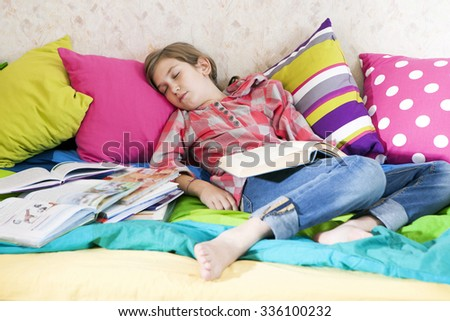 girl fell asleep while reading a book - stock photo