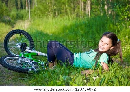 Girl fell from bike - stock photo