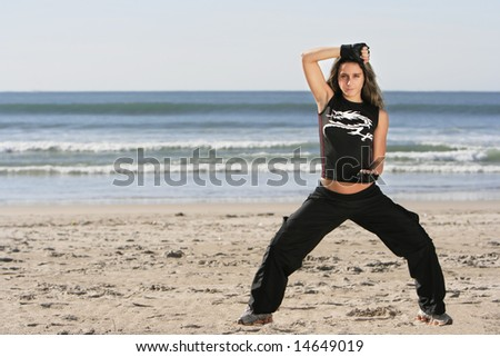 girl fighting in a the beach - stock photo