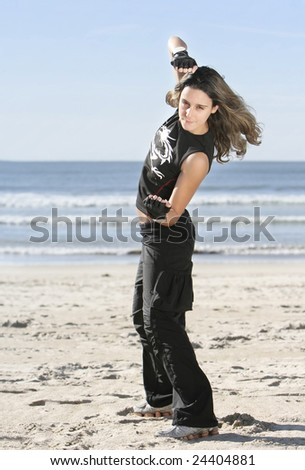 girl fighting in the beach - stock photo