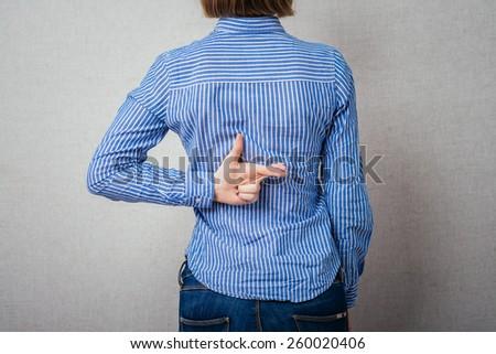 girl fingers crossed - stock photo
