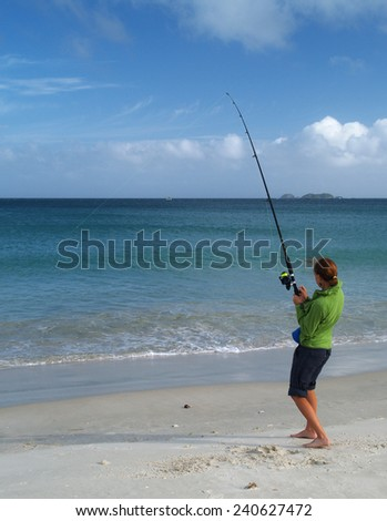 Girl fishing on the beach, New Zealand