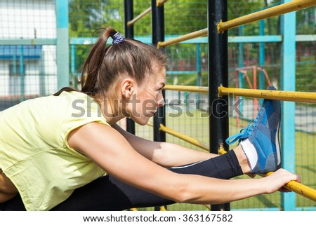 Girl fitness  jog workout .Sports young woman tying. Fit woman stretching her leg to warm up - stock photo