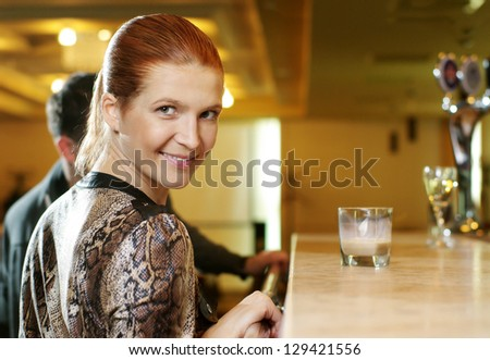 Girl flirting with guy in a bar - stock photo