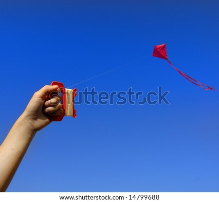 Girl flying a kite in a park with blue sky - stock photo