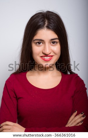 Girl folded her arms crosswise isolated - stock photo