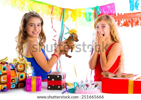 girl friends party excited with puppy chihuahua present dog in birthday - stock photo