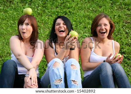 girl friends with apples outdoor - stock photo