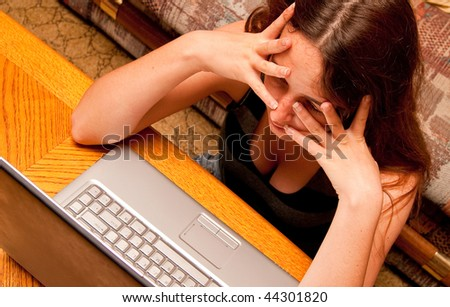 Girl Frustrated on Computer - stock photo