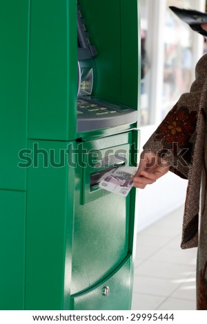 Girl gets 500 roubles from bank terminal - stock photo