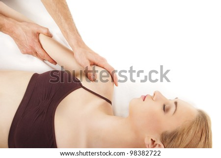 girl getting a massage - hands massaging her back - A pretty woman getting a shoulder and back massage
