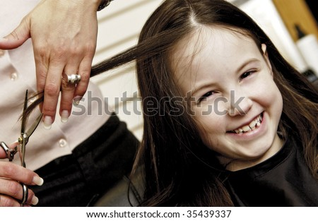 girl getting hair cut - stock photo