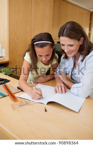 Girl getting help with her homework - stock photo