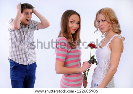 Girl gives another girl a flower on Valentine's Day