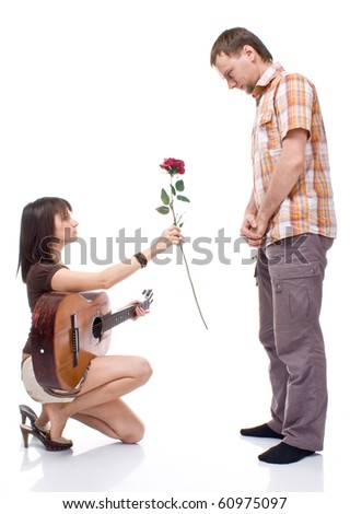girl gives the boy a rose on white background - stock photo