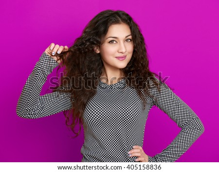 girl glamour portrait on purple background, long curly hair - stock photo
