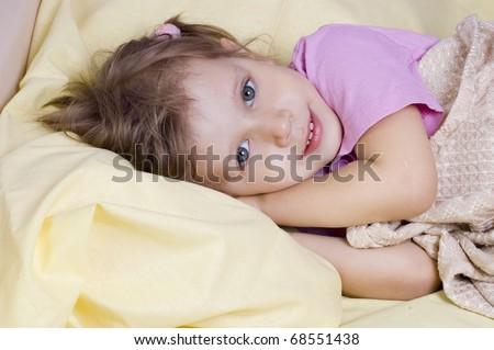 Girl go to sleep in bed - stock photo