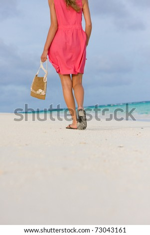 Girl goes for a walk on the coast of tropical island