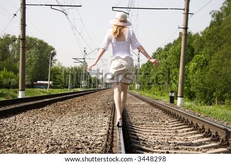 Girl going forward on a railway. - stock photo