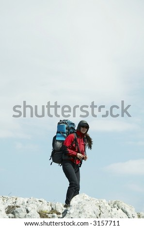 Girl going up along hill - stock photo