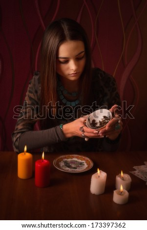 girl guesses on tea leaves - stock photo