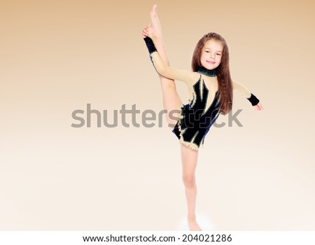 Girl gymnastic costume performs exercises.Happiness concept,happy childhood,carefree childhood - stock photo