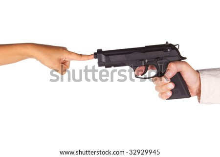 Girl hand aiming with pistol. a finger is covering the shot