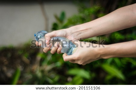 girl hand holding water balloon at blur natural background