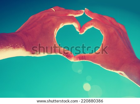 Girl hand in heart form love blue sky - stock photo