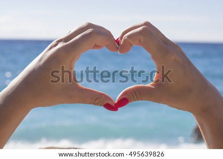 girl hands heart blue sky and blue sea