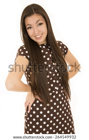 Girl hands on hip polka dot dress - stock photo