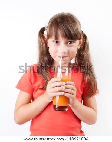 Girl happy to drink fresh orange juice - stock photo