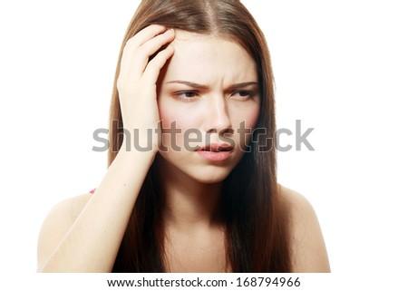 Girl has a headache, isolated on white - stock photo